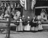 immigrant women standing in front of a butchershop at PA Museum