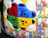 a colorful handmade kids quilt on display at the Kutztown Festival