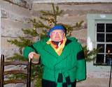 photo of an elf standing outside at Old Bedford Village Colonial Christmas event
