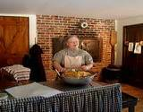 photo of a woman making old fashioned sugar cookies at Old Bedford Village Colonial Christmas event