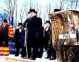 The famous Inner Circle announces the arrival of Punxsutawney Phil