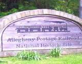 photo of a large rock with Allegheny Portage Railroad Museum logo printed on it