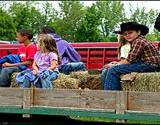 photo of kids on the back of a wagon on the Appalachian Wagon Train