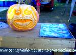 photo of a huge pumpkin carved into a beautiful work of art