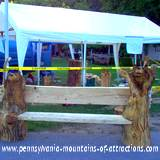 PA fall festival chainsaw sculpture bench at Lakemont Park