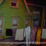 photo taken of reproduction of a typical house in Altoona in the 1950s with clothes hanging on a clothesline at ghost hunt at the Altoona Railroaders Memorial Museum