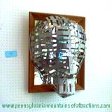 3 demensionial mask made from tin on display at Penn State Altoona Art Festival