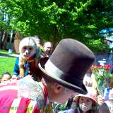 monkey sitting on trainers shoulder while entertaining children at Penn State Altoona Art Festival