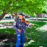 fiddler entertaining visitors to Penn State Altoona Art Festival