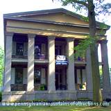 The main entrance view of Baker Mansion
