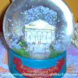 Snow globe of Baker Mansion celebrating 100th Year Anniversary of the Blair County Historical Society