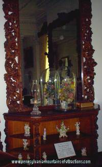 Mirror at Baker Mansion with ghostly orbs up in the corner of reflection