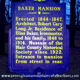 Heritage sign in front of Baker Mansion