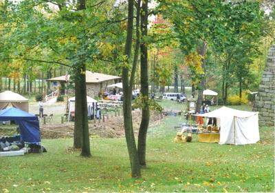vendor tents in a wooded setting