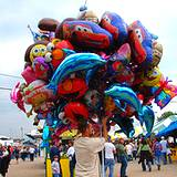 A man selling balloons at the Clearfield County Fair