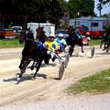 A photo of a harness race at Clearfield County Fair