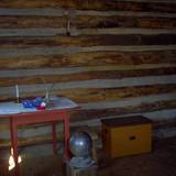 photo of the inside of a cabin and desk at Central Pennsylvania historic landmark Fort Roberdeau
