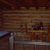 photo of the inside of a fort cabin and table and chairs at Central Pennsylvana historic landmark Fort Roberdeau