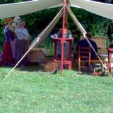 photo of a reenactment tent and re-enactors staying at Central Pennsylvania historic landmark Fort Roberdeau