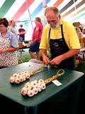 photo of a man demonstrating garlic braiding at the Pocono Garlic Festival