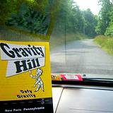 A brochure on the dashboad of car of Gravity Hill