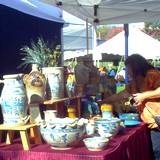 photo of a booth at the hartzlog festival displaying pottery