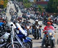 parade of bikers coming the streets