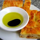 A photo of Italian bread with bowl of olive oil and balsmaic vinegar at Italian Food and Heritage Festival