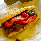 A photo of an Italian hoagie with red roasted peppers at the Italian Food and Heritage Festival