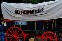 A covered wagon with big red wheels selling root beer at the Kutztown Fair