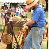 A photo of a broommaker at the Kutztown Fair