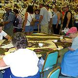 several ladies sitting around quilting at the Kutztown Festival