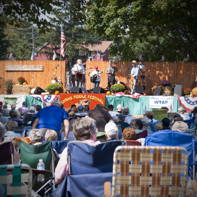 A record breaking crowd enjoyed a beautiful day of music at the 27th annual Lyons Fiddle Festival.