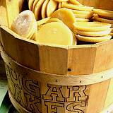 photo of a wooden bucket full of maple cakes at the Pennsylvania Maple Festival