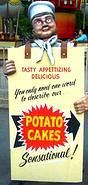photo of a man wearing a sign advertising potato cakes at Mountain Days celebration