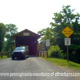 A piece of Pennsylvania history covered bridge leading to the Old Bedford Village