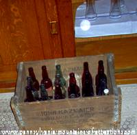 Case of empty beer bottles sitting on floor of Kelly's Bar