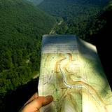 photo of hand holding a map of the PA Grand Canyon