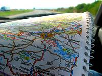picture of holding a PA road map while travelling down a PA Highway