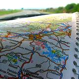 image of reading a road map while travelling in car