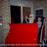 Children visiting Santa in his sleigh at Lakemont Park's Holiday Lights on the Lake.