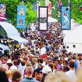 A huge crowd gathers on the streets of State College Central Pennsylvania of the Arts Festival