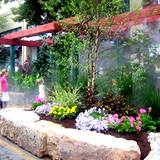 Cool mist spraying visitors and plants at State College Central Pennsylvania Festival of the Arts