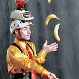 A juggler with bananas and a blender on his head, one part of entertainment at State College Central Pennsylvania Fetival of the Arts