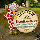 A StoryBook Forest welcome sign with clown