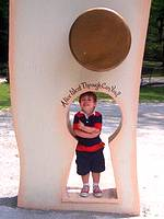 small boy standing in a keyhole at Storybook Forest