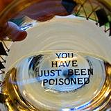 glass of water with message at bottom of glass
