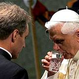 Pope Benedict drinking a glass of water