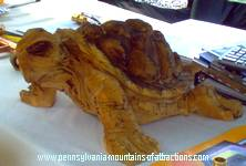 photo of a hand carved tortoise for sale at 7 Springs Resort
