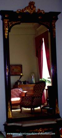 Mirror at Baker Mansion with picture of ghost reflection caught in the corner